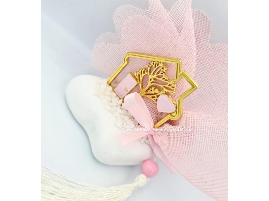 Mεταλλικό σπιτάκι πάνω σε πέτρα με ροζ σμάλτο