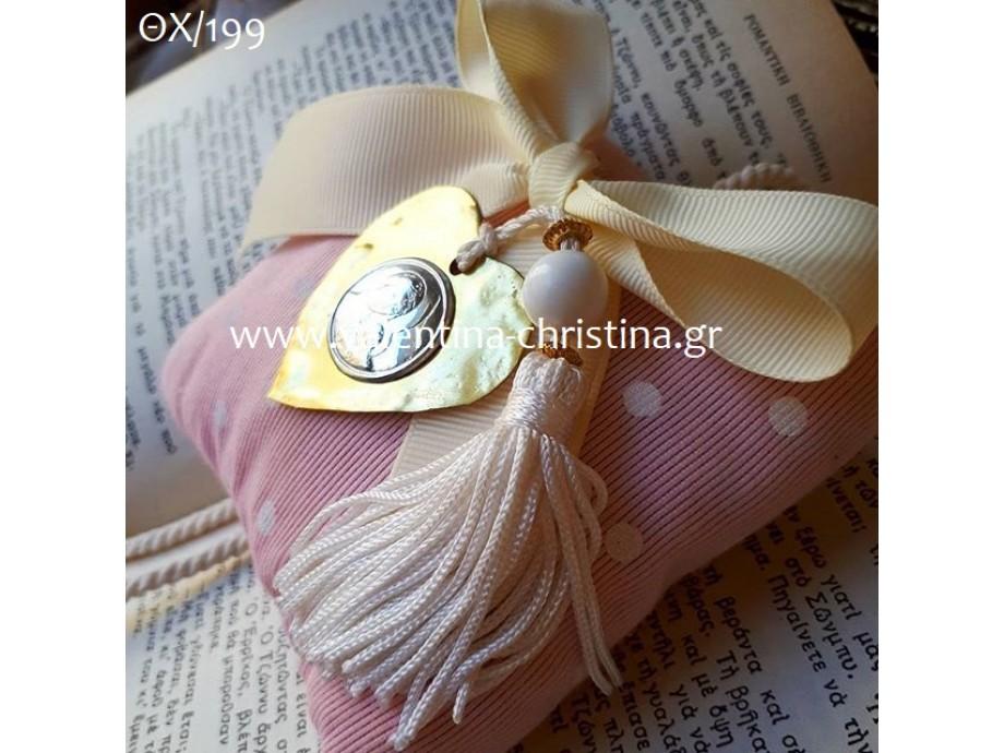 Εικόνα της Παναγίας πάνω σε μαξιλαράκι ροζ-πουά
