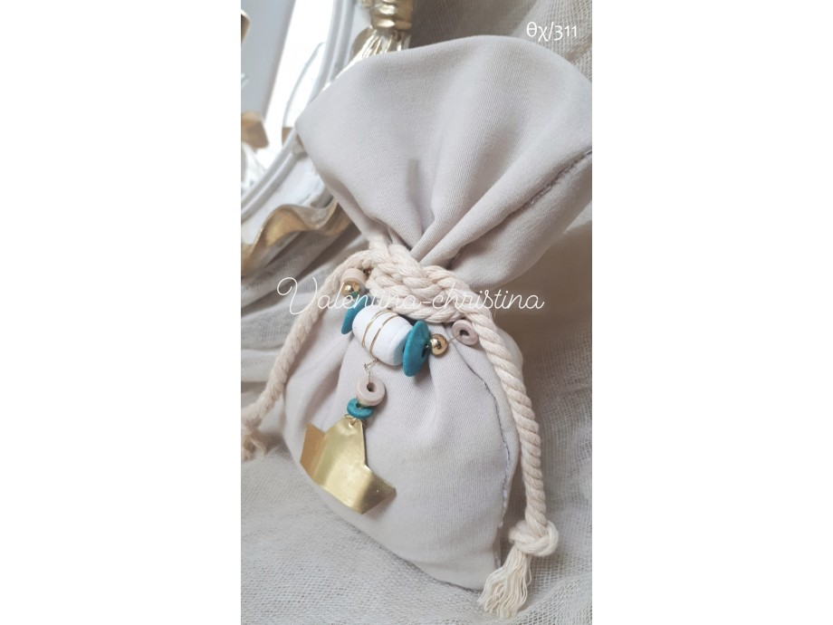 Πρωτότυπες μπομπονιέρες γάμου πουγκί της άμμου μεταλλικό καραβάκι