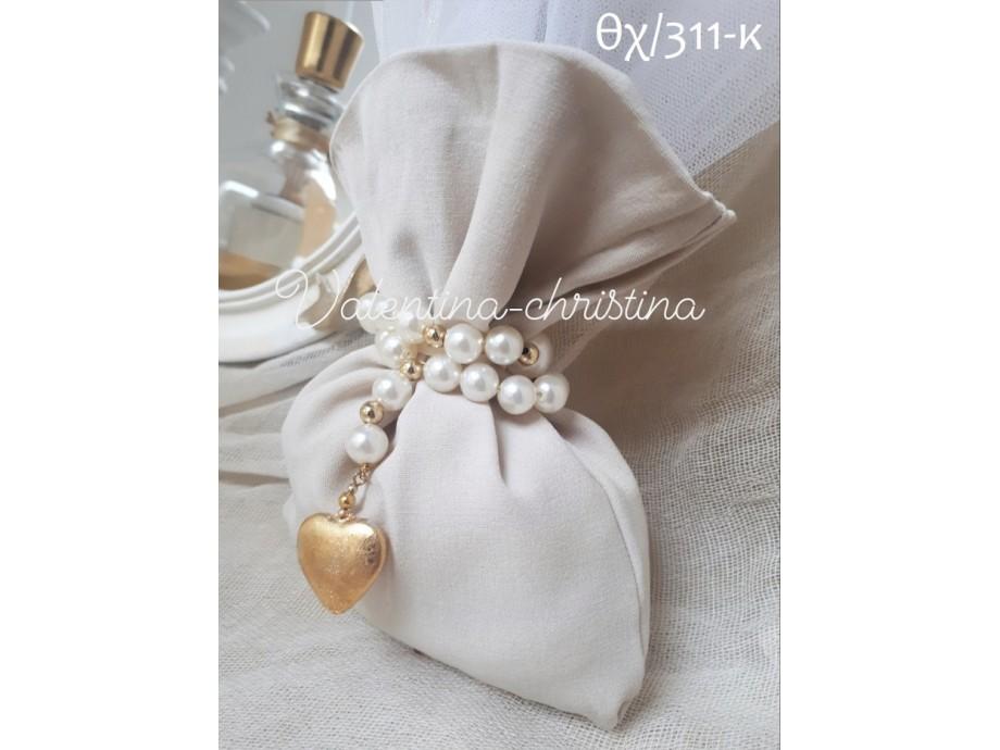 Πρωτότυπες μπομπονιέρες γάμου πουγκί της άμμου με καρδιά