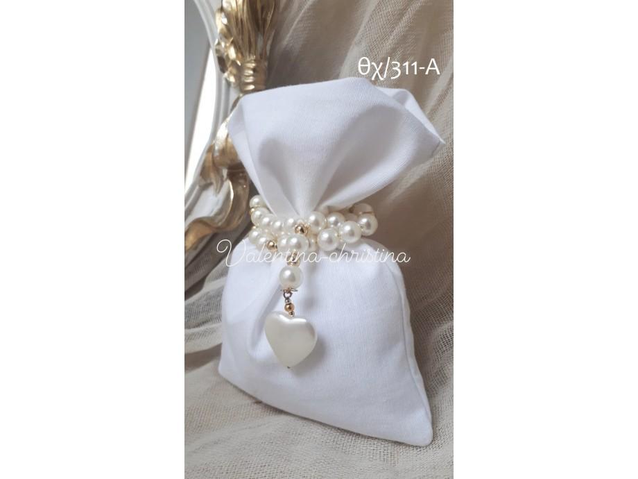 Πρωτότυπες μπομπονιέρες γάμου πουγκί άσπρο με καρδιά
